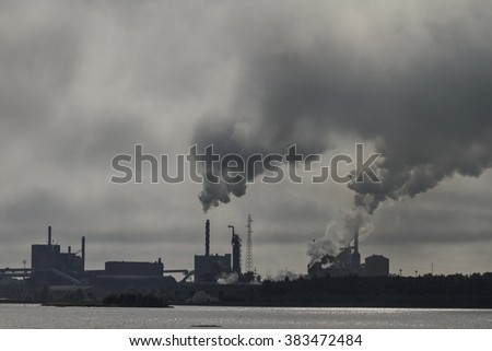 Landscape with factory chimneys, smoke, air pollutants - stock photo