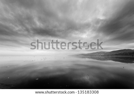 landscape with frozen lake and black clouds - stock photo