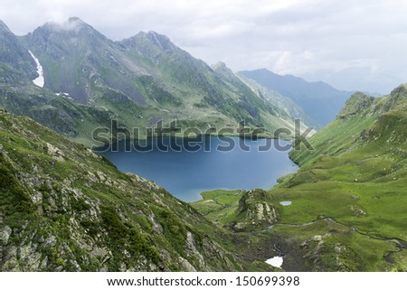 Landscape with high mountain, lake and clouds  - stock photo
