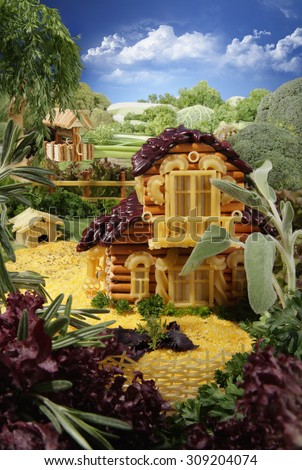 Landscape with homestead made from breadsticks, macaroni, snacks and others different foods. Handiwork. The image is made from multiple files.