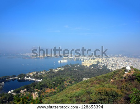 landscape with lake and palaces in Udaipur India - stock photo