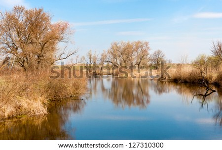 landscape with lake in forest in early spring time - stock photo