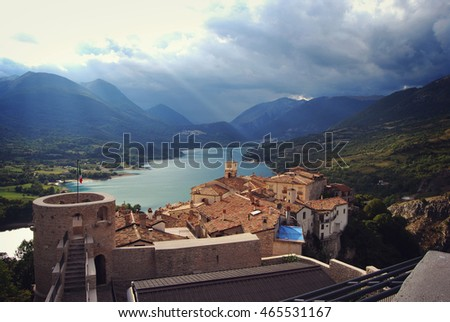 Landscape with lake, mountains and old town - Barrea, Italy. National park of Abruzzo, Lazio and Molise