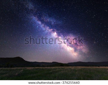 Landscape with Milky Way. Night sky with stars at mountains. - stock photo