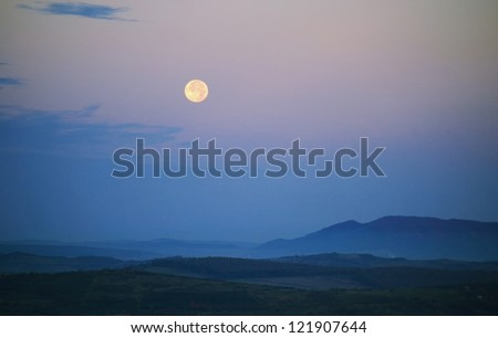 landscape with moon and hills - stock photo