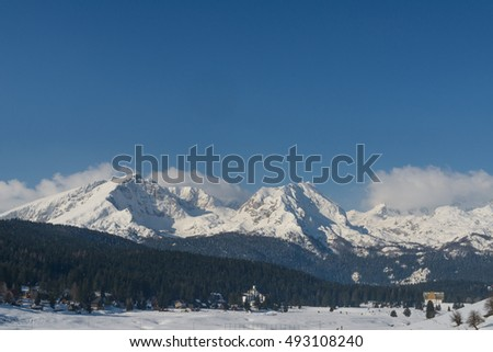 "Landscape with mountain peaks covered with snow. Winter day with blue sky. Mount ""Dormitory"" in Montenegro."
