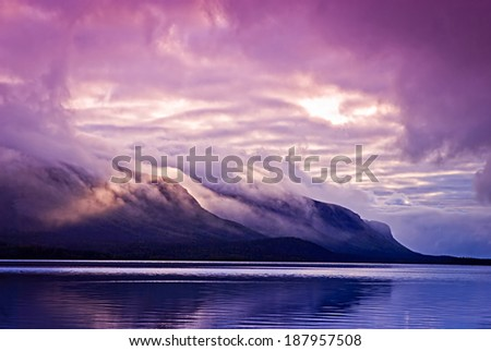 Landscape with mountains and clouds - stock photo