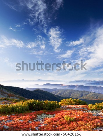 Landscape with mountains and cloudy sky - stock photo