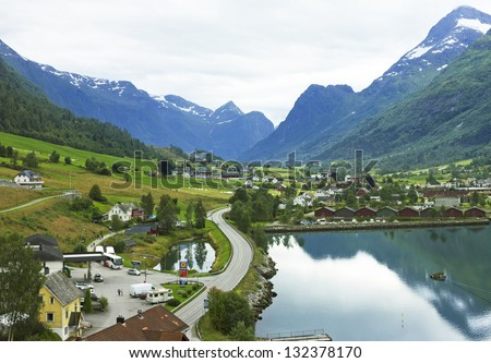 Landscape with mountains and rural houses in village Olden in Norwegian fjords. - stock photo