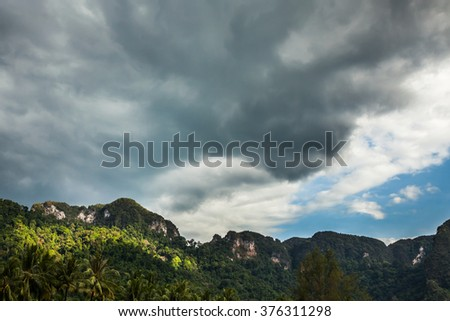Landscape with mountains and storm clouds  in Thailand.
