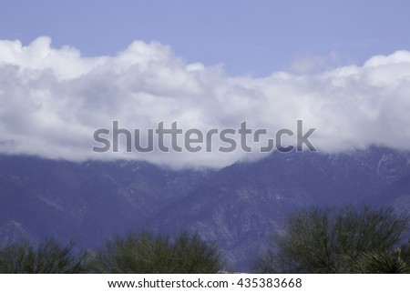 Landscape with mountains in the distance and desert floor near, from southern Utah