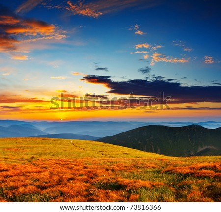 Landscape with mountains under morning sky with clouds