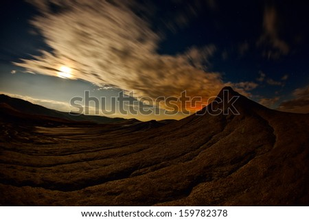 landscape with muddy volcanoes from Romania at sunset - stock photo