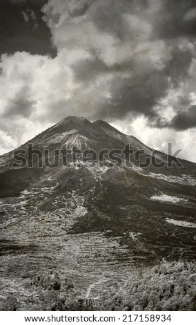 Landscape with old Indonesian volcano in Bali, Black and White toned photo - stock photo