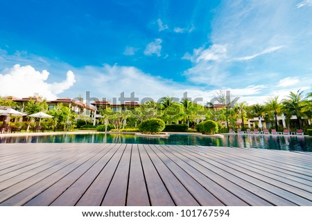 Landscape with pool village and blue sky and cloud - stock photo