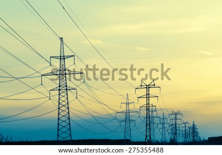 Landscape With Power Line In The Evening, cross-processing effect - stock photo