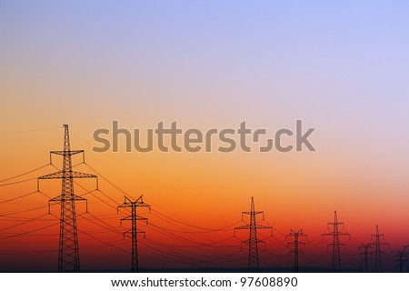 Landscape with Power Line on sunset. - stock photo