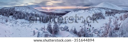 Landscape with purple colors, mountains, forest and snowfield. South Ural, Russia