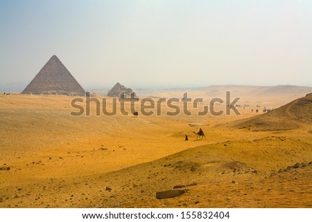 landscape with pyramids. Sunset. The inhabitants of the desert go home