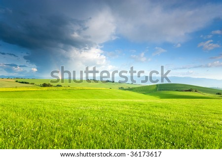 Landscape with rainbow (ideal for background or pattern) - stock photo