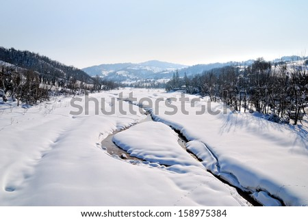 landscape with river and snow in winter