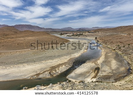 Landscape with river  and village at Gorges du Ziz, Morocco