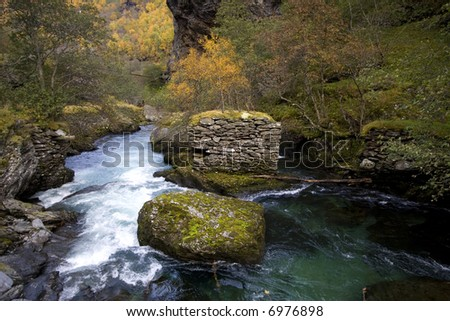 landscape with river surrounded by autumn colors - stock photo