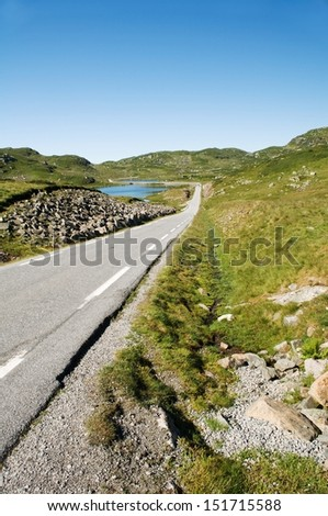 Landscape with road and lake in Norway - stock photo