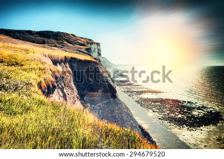 Landscape with rocky coast of North Sea at sunset. Normandy, France - stock photo