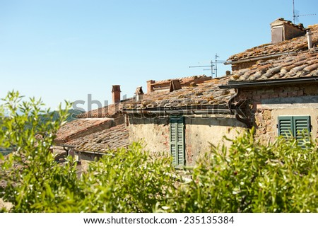Landscape with roofs of houses in small tuscan town Castelmuzio, Italy