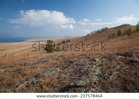Landscape with stones and clouds shot in Siberia - stock photo
