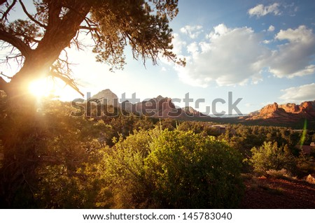 Landscape with sunlight in the red rock mountains in Sedona, Arizona in the American southwest - stock photo