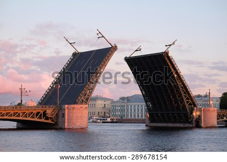 Landscape with the image of open Palace bridge from the Neva river in St. Petersburg, Russia,  - stock photo