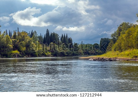 Landscape with the river on cloudy day - stock photo