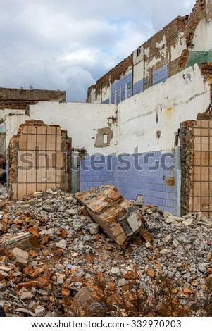Landscape with the ruins of old industrial factory buildings. The interior of an abandoned factory with rubble plunder and waste. Collapse of economy.  Selective focus as background for design trash