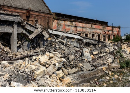 Landscape with the ruins of the old industrial factory buildings. The old industrial building after an earthquake.