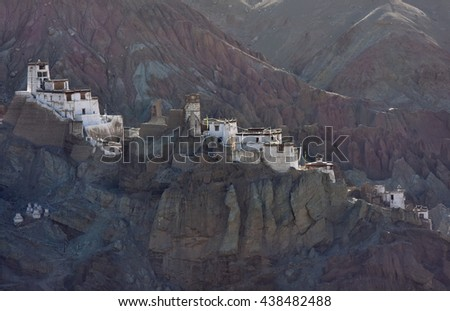 Landscape with Tibetan Buddhist monastery Basgo Gonpa at sunrise in the cliffs above above the mountain village Basgo, Ladakh, Himalayas, Northern India. - stock photo