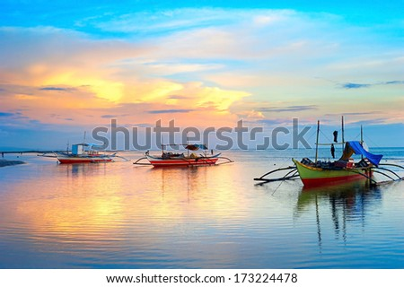 Landscape with traditional Philippines boats at sunset