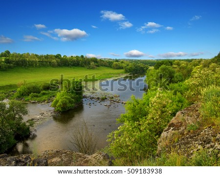 landscape with trees and a river