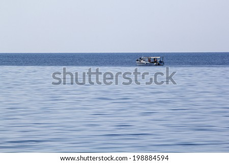 Landscape with water,boat and land in the background - Aegean sea, Greece
