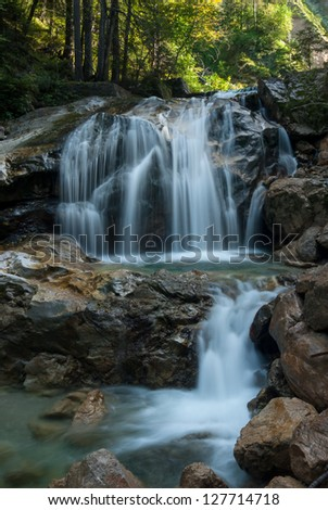Landscape with waterfall in mountains - stock photo