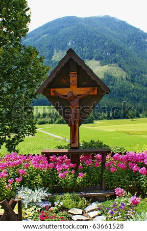 Landscape with wayside cross with statue of Jesus Christ. Styria,Austria. - stock photo