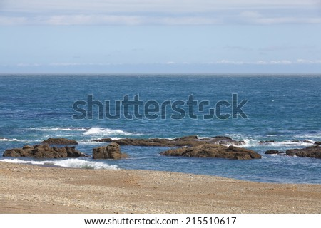 Landscape with white beach, the sea and  the blue sky