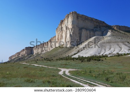 Landscape with white cliff against the blue sky - stock photo