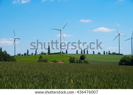 Landscape with wind energy turbines generating electricity