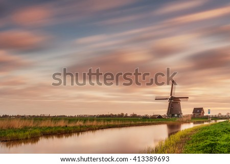 Landscape with windmill and beautiful sky, long exposure
