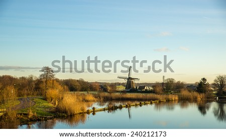 Landscape with windmill and canal