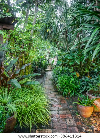 Landscaped Fresh garden. Beautiful Garden. The path in the garden. - stock photo