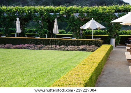 Landscaped Garden with Dining Tables - stock photo