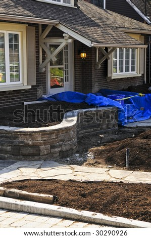 Landscaping and paving work in progress at a front yard of a house